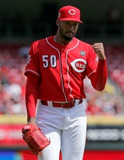 Cincinnati Reds relief pitcher Amir Garrett (50) pumps his fist as he returns to the dugout after pitching a scoreless eighth inning of the MLB National League game between the Cincinnati Reds and the Milwaukee Brewers at Great American Ball Park in downtown Cincinnati on Wednesday, April 3, 2019. The Reds lost 1-0 despite a seven inning, nine strikeout start from Castillo.