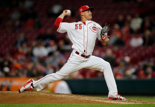 Cincinnati Reds relief pitcher Robert Stephenson (55) delivers a pitch in the eighth inning of the MLB National League game between the Cincinnati Reds and the Milwaukee Brewers at Great American Ball Park in downtown Cincinnati on Tuesday, April 2, 2019.