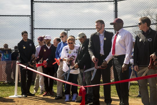 Eduardo and Shawna Rodriguez cut the ribbon to their daughter's softball field dedication with members of Western Hills University High School and the Reds Community Fund Wednesday, April 3, 2019 at Western Hills University High School. Gabrielle 'Gabby' Rodriguez, a Western Hills softball player, was killed by a motorist in September while crossing the street to catch her bus to school.
