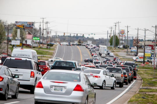Traffic stacks up in the northbound lanes with the southbound lanes closed while Clarksville Police officers investigate a drive-by shooting that occurred at 1887 Fort Campbell Blvd in Clarksville, Tenn., on Wednesday, April 3, 2019.