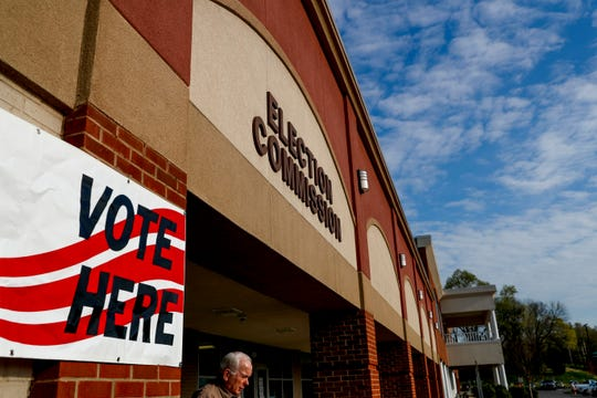 A resident exits the building after casting his ballot on the first morning of early voting at the Montgomery County Election Commission in Clarksville, Tenn., on April 3, 2019.