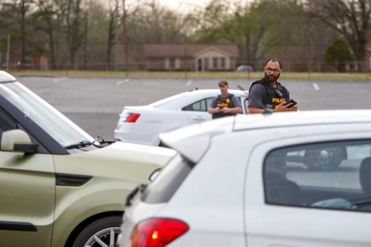Clarksville Police officers investigate a drive-by shooting that occurred at 1887 Fort Campbell Blvd in Clarksville, Tenn., on Wednesday, April 3, 2019.