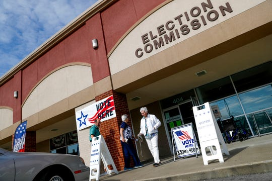 Residents enter and exit the Montgomery County Election Commission to cast their ballot on the first morning of early voting in Clarksville, Tenn., on Wednesday, April 3, 2019.