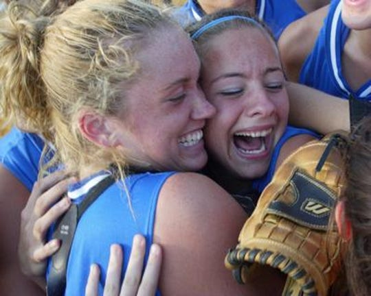 Erica Lordi, center, and catcher Meghan Reilly celebrate the Middlesex High School softball team's 10-0 NJSIAA Group I final victory over Cedar Grove at Toms River North High School on June 7, 2004