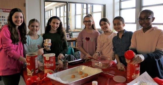 Students at Edison Intermediate School make dog treats for local animal shelters as part of a districtwide Community Service Week in Westfield Public Schools.