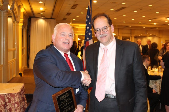 Steven L. Fox, a partner with Red Bank-based law firm Lindabury, McCormick, Estabrook & Cooper, P.C., received the Robert J. Cirafesi Chancery Practice Award on Wednesday, March 20, at Middlesex County Bar Association's 14th Annual Practice Area Awards Dinner at Pines Manor in Edison. (Leftto right)Steven Fox and Lindabury President David R. Pierce.