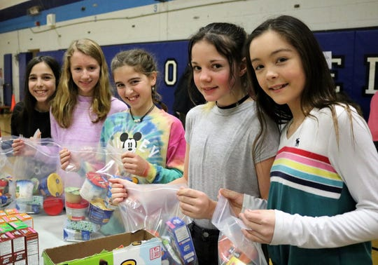 Roosevelt Intermediate School students assemble snack packs for the Rotary Club of Westfield's backpack initiative which helps children who receive food assistance through school programs but who may not have enough to eat throughout the weekend.