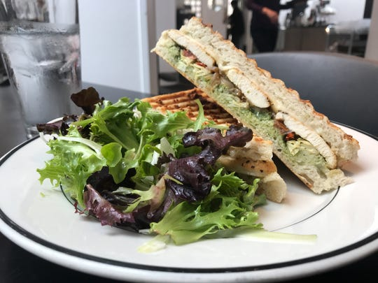 The chicken vegetable panini with seared chicken, caramelized onions, oven-roasted tomato, artichoke hearts, Swiss cheese and basil pesto.