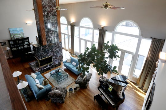 The living room and dining room of this home in Plymouth Township share a ceiling that is 22 feet high. The two rooms are divided only by a two-story fireplace featuring Turkish marble.