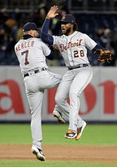 Detroit Tigers shortstop Jordy Mercer (7) and outfielder Niko Goodrum (28) celebrate after defeating the New York Yankees in a baseball game against the New York Yankees, Tuesday, April 2, 2019, in New York.