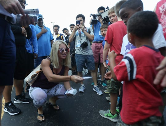 Kelly Stafford, the wife of Detroit Lions quarterback Matthew Stafford, hands out tickets to a preseason game Wednesday, Aug. 3, 2016, at the practice facility in Allen Park MI. Kirthmon F. Dozier/Detroit Free Press