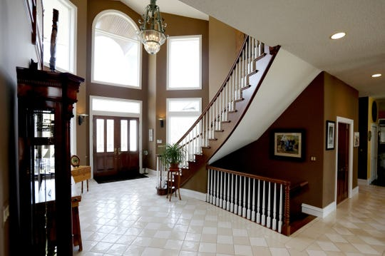 The front doors of this home designed with a southern plantation in mind open into a foyer with a sweeping staircase. The home is on Ridge Road in Plymouth Township, Michigan.