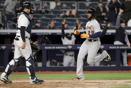 New York Yankees catcher Austin Romine (28) has no play as Detroit Tigers Niko Goodrum (28) runs home to score on Dustin Peterson's game-winning RBI double in the ninth inning of a baseball game, Tuesday, April 2, 2019, in New York.