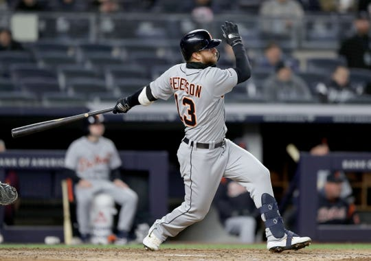 Dustin Peterson #13 of the Detroit Tigers drives in the game winning run with this RBI double in the ninth inning against the New York Yankees at Yankee Stadium on April 02, 2019 in the Bronx borough of New York City.