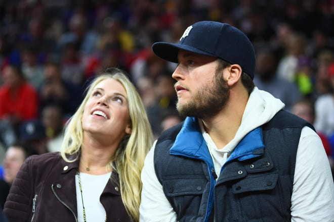 Detroit Lions quarterback Matthew Stafford with his wife, Kelly Stafford, during a Nov. 17, 2015 game between the Detroit Pistons and the Cleveland Cavaliers at The Palace of Auburn Hills.