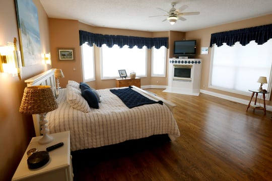 The first-floor master bedroom is one of five bedrooms in this large home in Plymouth Township, Michigan. Each bedroom has its own bathroom.