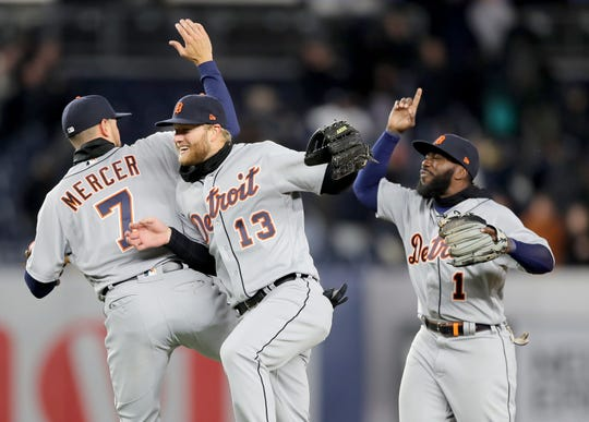Jordy Mercer #7,Dustin Peterson #13 and Josh Harrison #1 of the Detroit Tigers celebrate the 3-1 win over the New York Yankees at Yankee Stadium on April 02, 2019 in the Bronx borough of New York City.