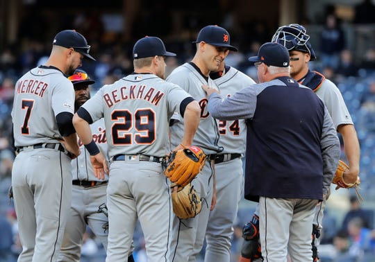 Detroit Tigers starting pitcher Matthew Boyd, center, smiles as manager Ron Gardenhire, right, takes him out of the game against the New York Yankees during the seventh inning Wednesday, April 3, 2019, in New York.