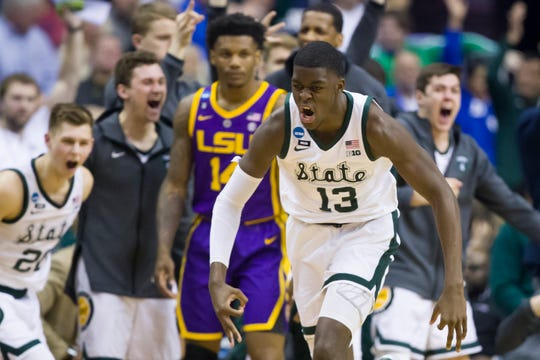 Michigan State forward Gabe Brown and teammates react after he made a 3-pointer against LSU.