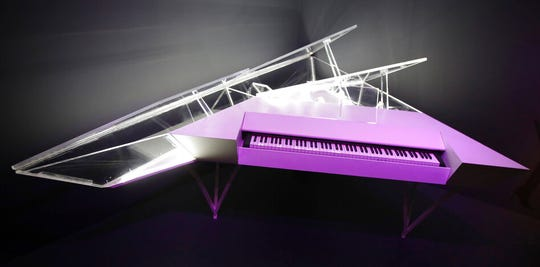 An electric piano with a customized housing used by Lady Gaga is displayed.