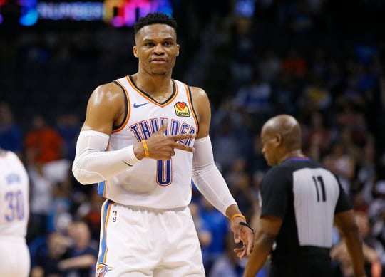 Oklahoma City Thunder guard Russell Westbrook gestures to the crowd in the second half of Tuesday night's game against the Los Angeles Lakers.