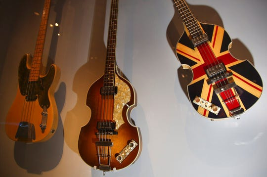 Guitars, including a bass, right, designed for Paul McCartney on the occasion of Queen Elizabeth's Diamond Jubilee celebration, are displayed.