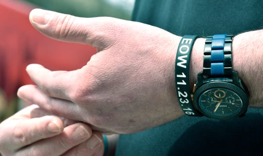 Chris Powell, president of the Collin Rose Memorial Foundation, wears an End of Watch (EOW) bracelet in honor of his best friend, WSU Police Sgt. Collin Rose, who was fatally shot on November 23, 2016.