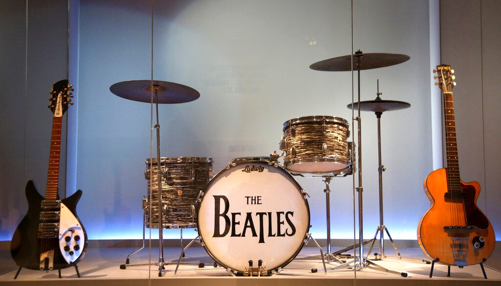 Instruments used by members of The Beatles are displayed at the exhibit.