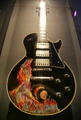 A guitar decorated by Keith Richards of The Rolling Stones is displayed.
