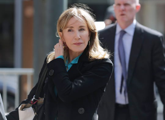 Actress Felicity Huffman arrives at federal court in Boston on Wednesday, April 3, 2019.