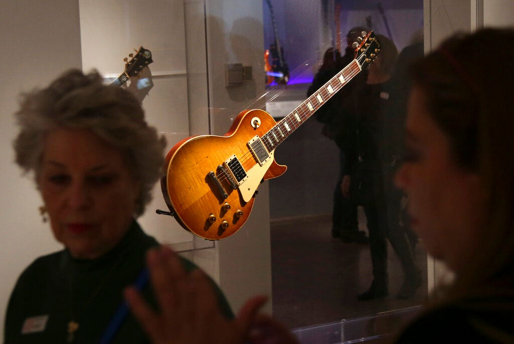"""Electric guitars are displayed at the exhibit """"Play It Loud: Instruments of Rock & Roll,"""" at the Metropolitan Museum of Art in New York, Monday, April 1, 2019."""