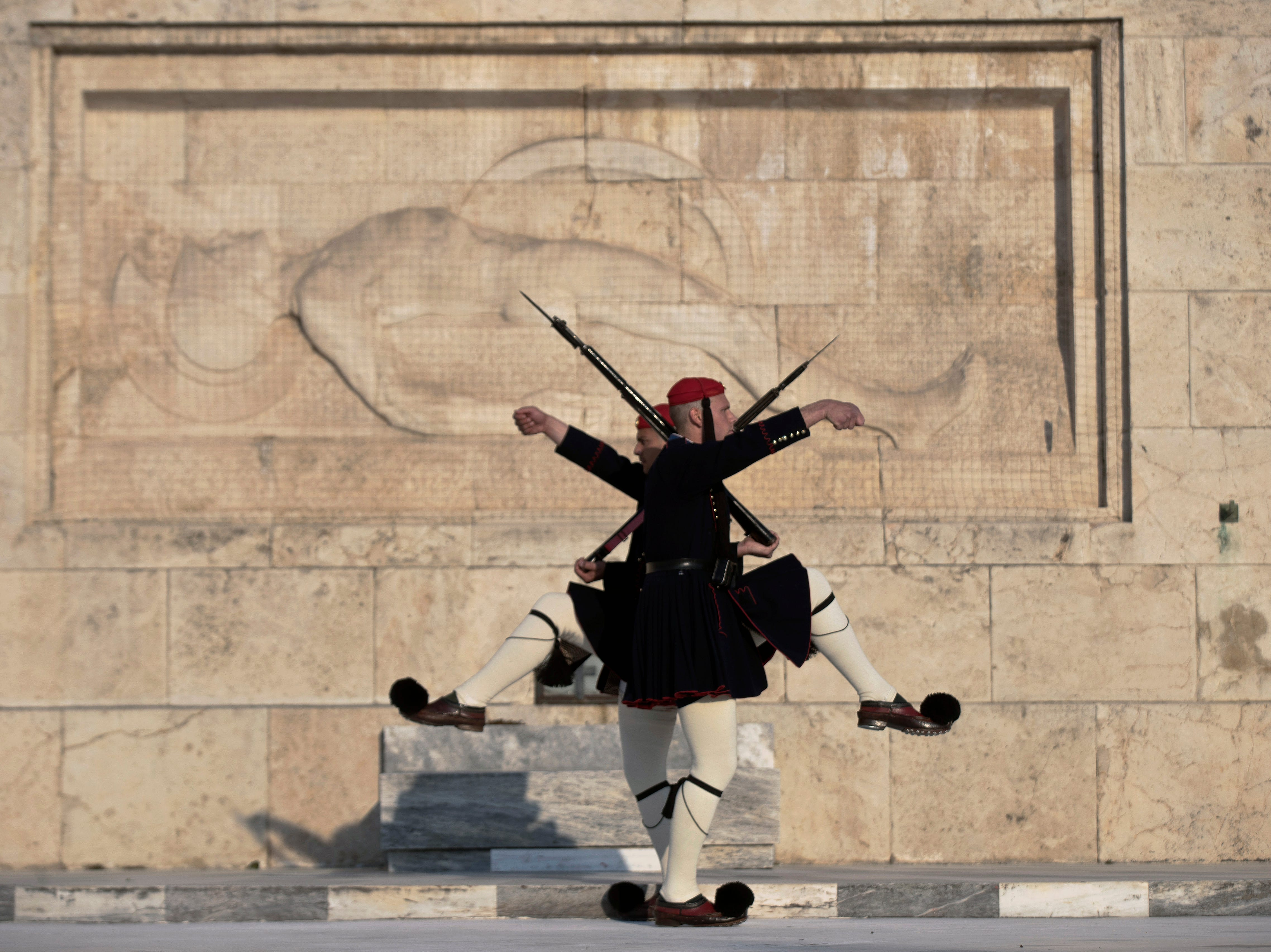 Greek Presidential guards take part in the changing of the guard ceremony, at the tomb of the unknown soldier in front of the Parliament, central Athens, on Wednesday, April 3, 2019.