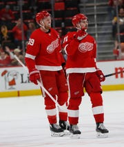 Detroit Red Wings right wing Anthony Mantha (39) and center Dylan Larkin celebrate Mantha's empty-net goal during the third period Tuesday night.