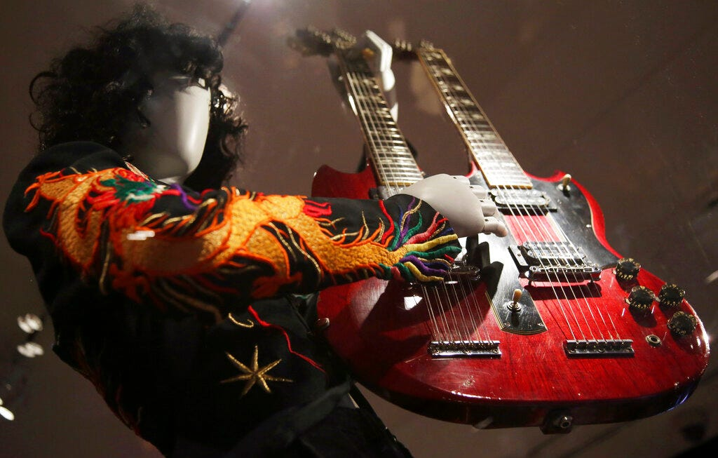A double-neck guitar played by Jimmy Page of Led Zeppelin is displayed.