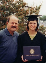 Kerri Rawson and her father Dennis Rader at her college graduation from Kansas State University in May 2003.