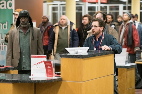 "Writer-director Emilio Estevez stars in ""The Public"" as Stuart Goodson, a librarian who starts his day chumming it up with the homeless class."