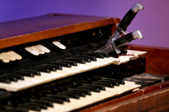 A stunt organ with knives that Keith Emerson used to hold notes is displayed.