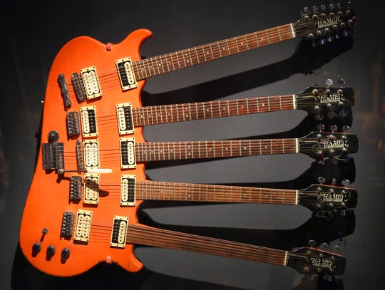 A five-neck guitar used by Rick Nielsen of Cheap Trick is displayed.