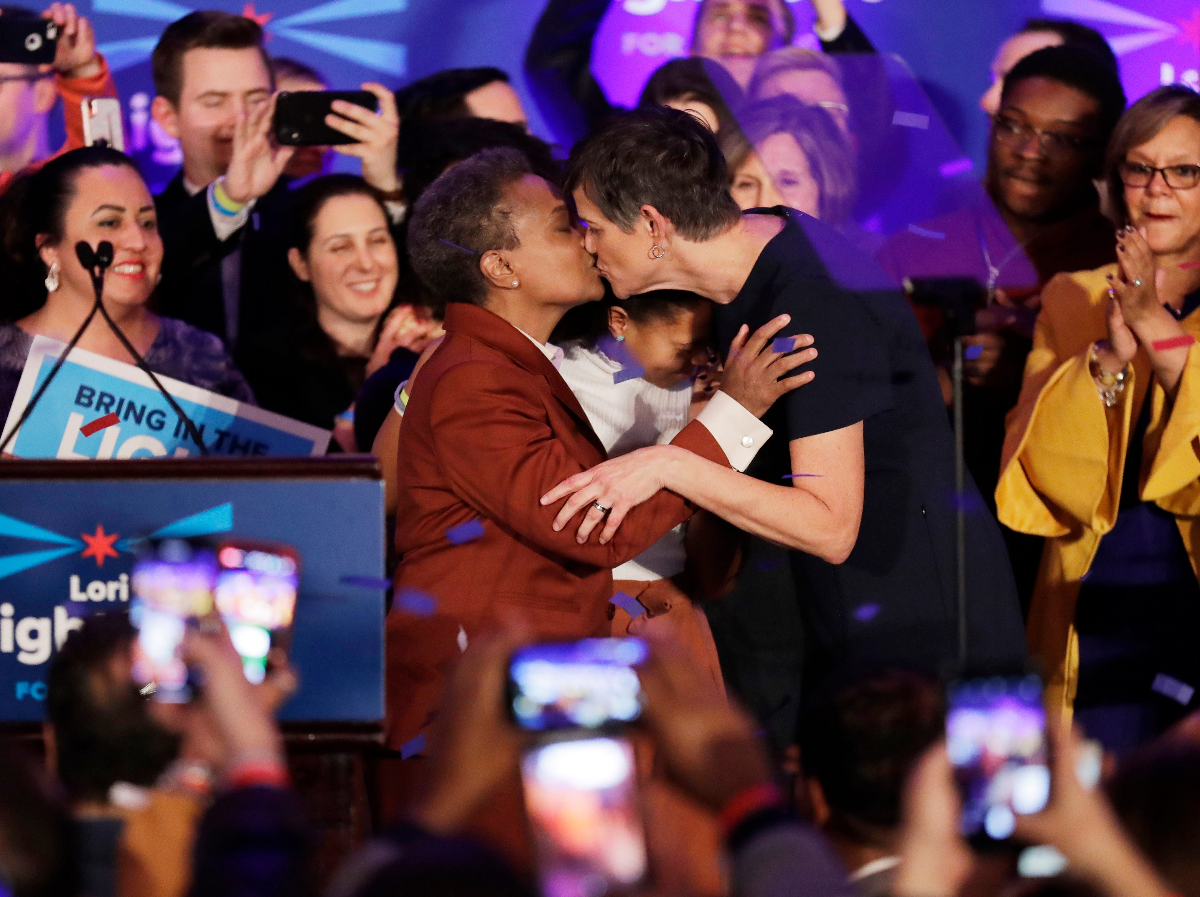 Lori Lightfoot, left, kisses her spouse Amy Eshleman at her election night party Tuesday, April 2, 2019, in Chicago. Lori Lightfoot elected Chicago mayor, making her the first African-American woman to lead the city.