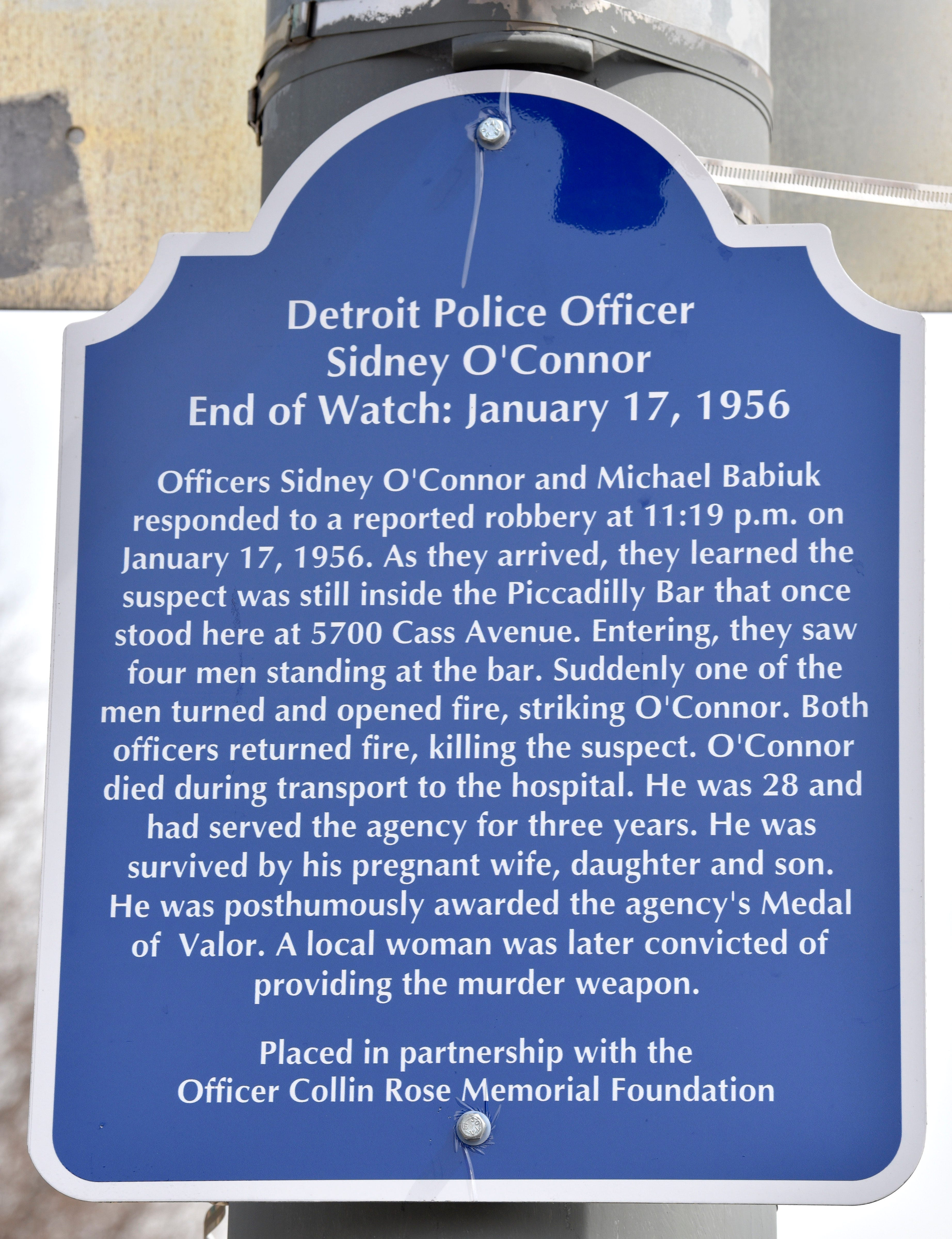 The End of Watch sign for fallen Detroit Police Officer Sidney O'Connor, who died in the line of duty on January 17, 1956, is  displayed on a pole at the intersection of Cass and West Palmer in Detroit.