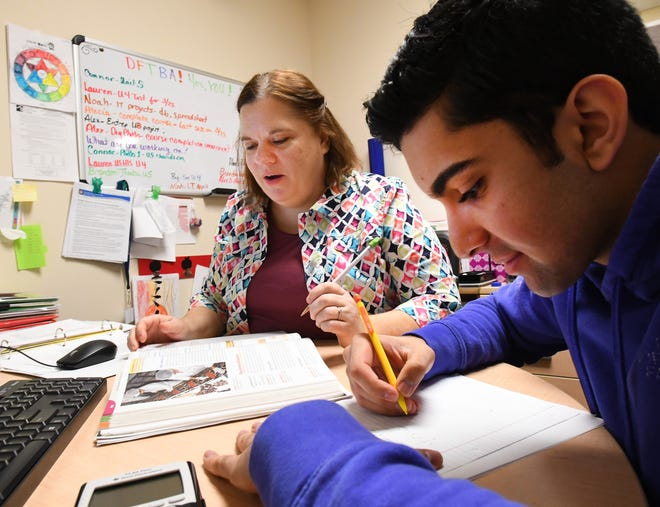 Student Alex Danish, 18, works with instructor Dawn Raymond of Brightmont Academy, using materials she has purchased from Bookstock in Livonia.
