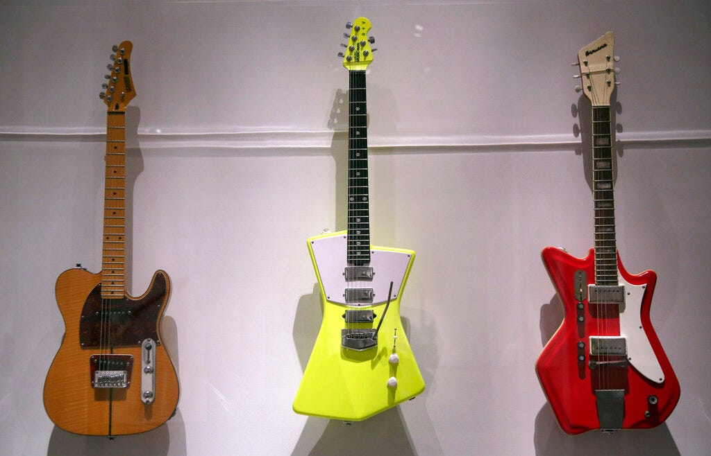 """Electric guitars are displayed at the exhibit """"Play It Loud: Instruments of Rock & Roll."""""""