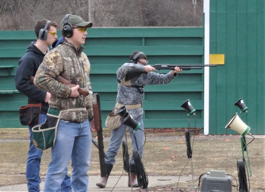 Corning-Painted Post High School trap team members Owen Zahradra, foreground, Connor Carrigan and Alex Tomb (shooting,) take part in shooting practice at the Corning Fish and Game Club.