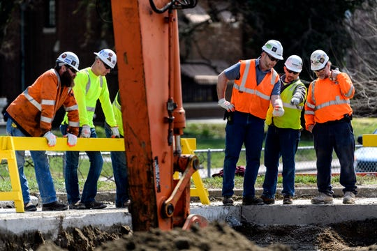 Skanska crew members oversee the digging of a 13-14 foot  hole to install a new 36 inch water pipe during water utility construction that shut down Veterans Memorial Parkway from Shawnee Drive to the intersection of Riverside and Cherry Street in downtown Evansville, Ind., Wednesday, April 3, 2019. The pipes, which bring water to nearly half of the city's residents, are being replaced as a preventative measure. The work and road closures are expected to take seven to ten days.