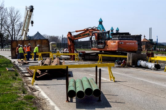 Skanska crew members work on a water utility construction project that shut down Veterans Memorial Parkway from Shawnee Drive to the intersection of Riverside and Cherry Street in downtown Evansville, Ind., Wednesday, April 3, 2019. The work and road closures are expected to take seven to ten days.
