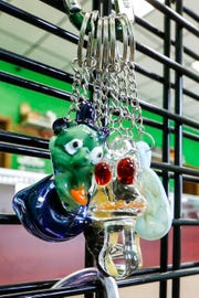 A variety of glass pendants and keychains hang on display at Goblinz Glass in Fond du Lac.