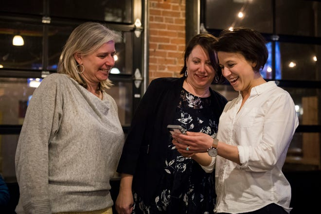 City Council candidates, from left, Julie Pignataro, Kristin Stephens, and Emily Gorgol react after seeing a photo taken of the three of them by Pignataro's campaign manager Haley Ratcliff at an election watch party at Prost Brewing Co. & Biergarten on Tuesday, April 2, 2019, in Fort Collins, Colo. Joined by Susan Gutowsky, who also won election, women make up the majority of City Council for the first time.