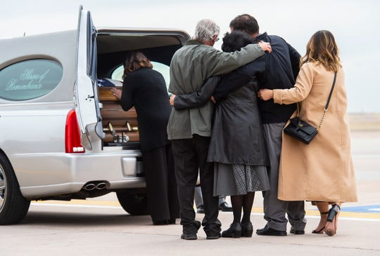 Family members pay their respects to Sgt. 1st Class Will Lindsay during a transfer ceremony, Wednesday, April 3, 2019, at Peterson Air Force Base in Colorado Springs, Colo. Lindsay, a member of the Second Battalion of the 10th Special Forces Group, died on March 22 as a result of injuries he suffered during combat operations in Kunduz Province.  (Christian Murdock/The Gazette via AP)