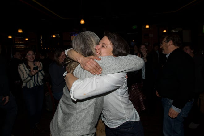 City Council District 2 candidate Julie Pignataro, left, and District 6 candidate Emily Gorgol react as election results are announced at an election watch party Tuesday. at Prost Brewing Co.