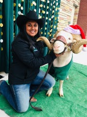 Jessica Balasuriya poses with Cam the Ram. She quit being a Ram Handler after feeling excluded because of her skin color and lack of agricultural background.